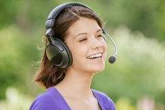 Portrait of young woman wearing headphones Stock Images
