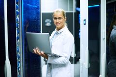 Female Scientist Working with Supercomputer Stock Image