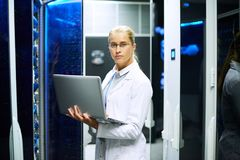 Female Scientist Posing with Supercomputer