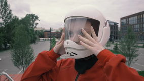 Portrait young woman wearing a protective helmet. Girl in protective helmet stock footage