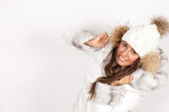 Portrait of young woman wearing puffer jacket with hood Stock Images
