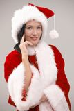 Portrait of young woman wearing santa costume Stock Images