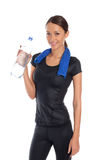 Portrait of young woman wearing sport clothes and drinking water Royalty Free Stock Photography