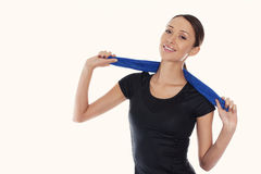 Portrait of young woman wearing sport clothes on a white backgro Royalty Free Stock Photo
