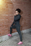 Portrait of young woman wearing sportswear. On city street royalty free stock image