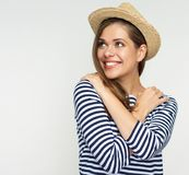 Portrait of young woman wearing striped shirt. Smiling girl with straw mexican hat isolated portrait Royalty Free Stock Image