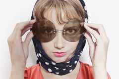 Portrait of a young woman wearing sunglasses and headscarf Royalty Free Stock Photography
