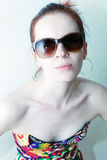 Portrait of young woman wearing a sunglasses Royalty Free Stock Photography