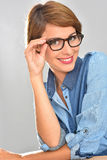 Portrait of young woman wearing trendy eyeglasses Stock Photo