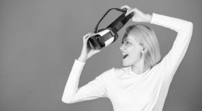 Portrait of young woman wearing VR goggles, experiencing virtual reality using 3d headset. Woman with virtual reality. Headset. Confident young woman adjusting stock image