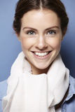 Portrait of a young woman, wearing a white scarf Royalty Free Stock Photo