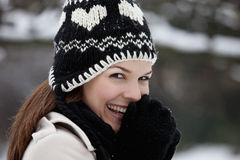 Portrait of a young woman wearing a woolen hat, smiling Stock Photo