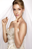 Portrait of  young woman in wedding dress posing with white brid Royalty Free Stock Images