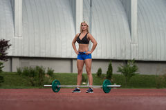 Portrait Of A Young Woman With Weights Outdoor Stock Photos