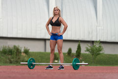 Portrait Of A Young Woman With Weights Outdoor Royalty Free Stock Image