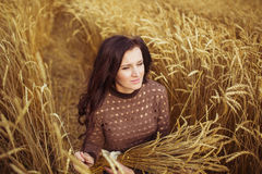 Portrait of a young woman with a wheat on a field Stock Photo