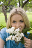 Portrait of young woman with white branch of lilac Royalty Free Stock Photography