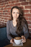 Young Woman with Beautiful Green Eyes with White Coffee Cup Stock Photography
