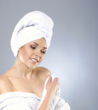 Portrait of a young woman in a white cotton towel Royalty Free Stock Photography