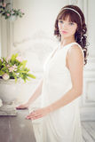 Portrait of a young woman in white dress Royalty Free Stock Image
