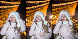 Portrait of young woman with white fur cap talking on mobile outdoor in cold winter evening. Beautiful blonde girl in winter Royalty Free Stock Image
