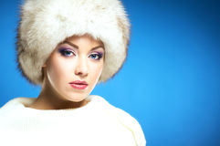 Portrait of a young woman in a white fur hat Stock Photo