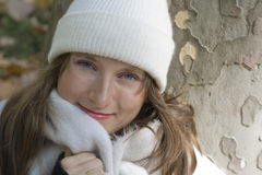 Portrait of young woman in white hat and scarf Stock Photography