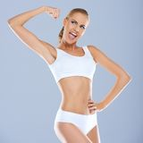 Portrait of young woman in white sportsbra smiling Stock Photos
