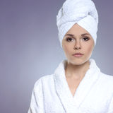 Portrait of a young woman in a white towel Stock Images