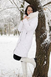 Portrait of the young woman in white at a tree Royalty Free Stock Photos