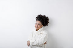 Portrait of a young woman in white turtleneck. Copy space Stock Photos
