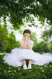 Portrait of young woman in white wedding dress Stock Images
