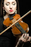 Portrait of a young woman who plays the violin Stock Photography