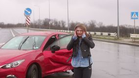 Portrait of a young woman who was in a car accident in bad weather. Portrait of a young woman who was in a car accident in bad weather, she is standing near a stock video footage