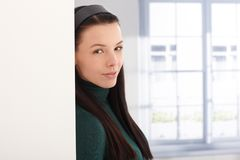Portrait of young woman by window Royalty Free Stock Photos