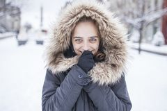 Portrait of young woman with winter coat Royalty Free Stock Images