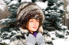 Portrait of young woman in winter forest Royalty Free Stock Photos