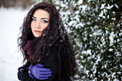 Portrait of young woman in winter forest Stock Photography