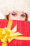 Portrait of a young woman in a winter hat holding a present Stock Images
