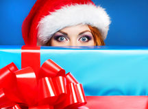 Portrait of a young woman in a winter hat holding a present Stock Photography