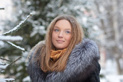 Portrait of young woman in winter park Royalty Free Stock Image