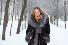 Portrait of young woman in winter park Stock Photos