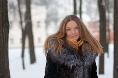 Portrait of young woman in winter park Royalty Free Stock Photography