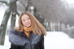 Portrait of young woman in winter park Stock Image