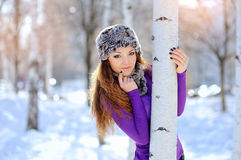 Portrait of a young woman in winter park Stock Photos