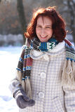 Portrait of young woman in a winter park outdoors Royalty Free Stock Images