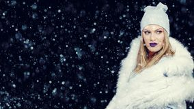 Portrait of young woman in wintertime outdoor Christmas stock photo