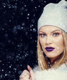Portrait of young woman in wintertime outdoor Christmas stock images