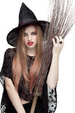 Portrait of young woman in witch costume royalty free stock photo