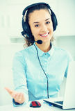 Portrait of young woman working in call center Royalty Free Stock Photo